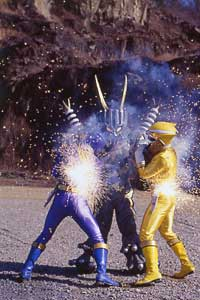 Yellow Ranger assisting the Blue Ranger in fighting Plug Org
