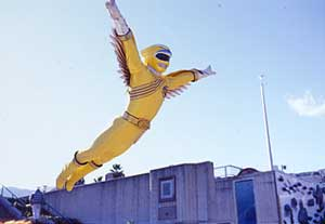 Yellow Ranger flying through the air