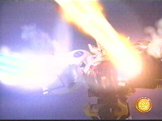 Wild Force Megazord (Double Knuckle Mode) fires the Bear Blasters